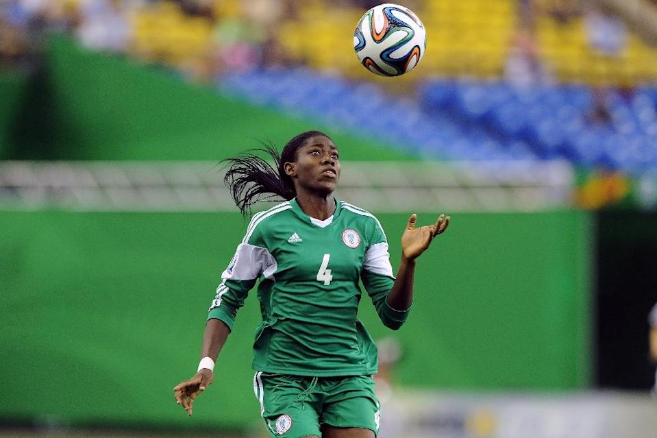 After going to every World Cup since 1991, Nigeria hope to finally bring the trophy home with a blend of young talent like Asisat Oshoala, pictured, Desire Oparanozie and Francisca Ordega alongside experienced campaigners (AFP Photo/Richard Wolowicz)