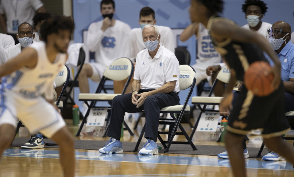 North Carolina coach Roy Williams watches his team on defense in first half against College of Charleston during the first half of an NCAA college basketball game Wednesday, Nov. 25, 2020, in Chapel Hill, N.C. (Robert Willett/The News & Observer via AP, Pool)