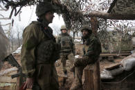 Ukrainian soldiers in a trench on the front line near the town of Novoluhanske in the Donetsk region, Ukraine, Monday, Dec. 9, 2019. A long-awaited summit in Paris on Monday aims to find a way to end the war in eastern Ukraine, a conflict that after five years and 14,000 lives lost has emboldened the Kremlin and reshaped European geopolitics. (AP Photo/Vitali Komar)