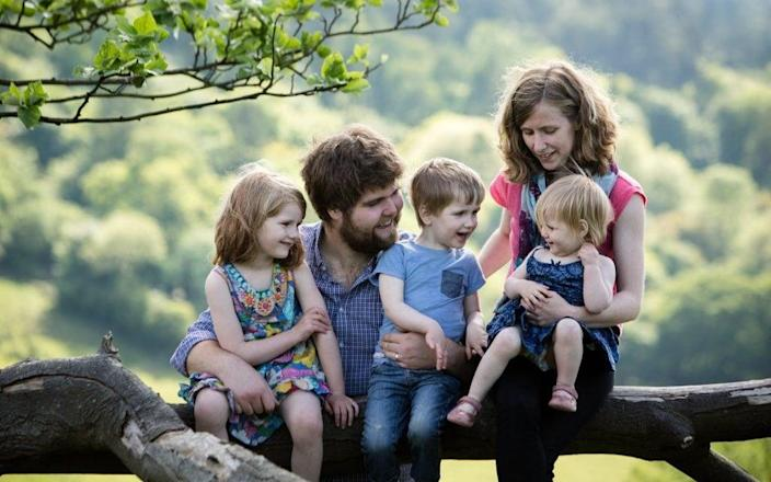 Zoe and Joshua Powell with three of their children - Sarah Mak Photography