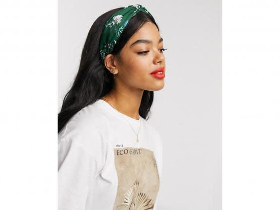 Tame flyaways and keep loose strands at bay while you're working with a colourful headband (Asos)