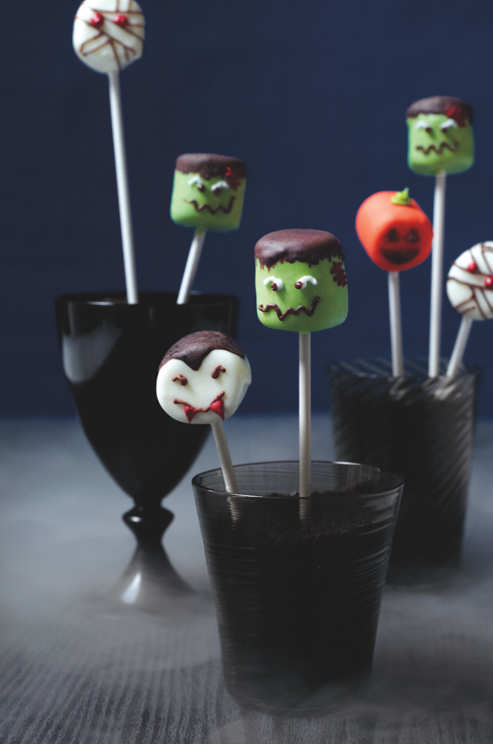 """<p>If you don't have too much time to bake but you want a dessert that's as spooky as the rest of the Halloween party you've organized, then these are the dessert for you. </p><strong><em><a href=""""https://www.womansday.com/food-recipes/food-drinks/recipes/a11873/marshmallow-heads-recipe-123439/"""" rel=""""nofollow noopener"""" target=""""_blank"""" data-ylk=""""slk:Get the Marshmallow Monster Heads recipe."""" class=""""link rapid-noclick-resp"""">Get the Marshmallow Monster Heads recipe.</a></em></strong>"""