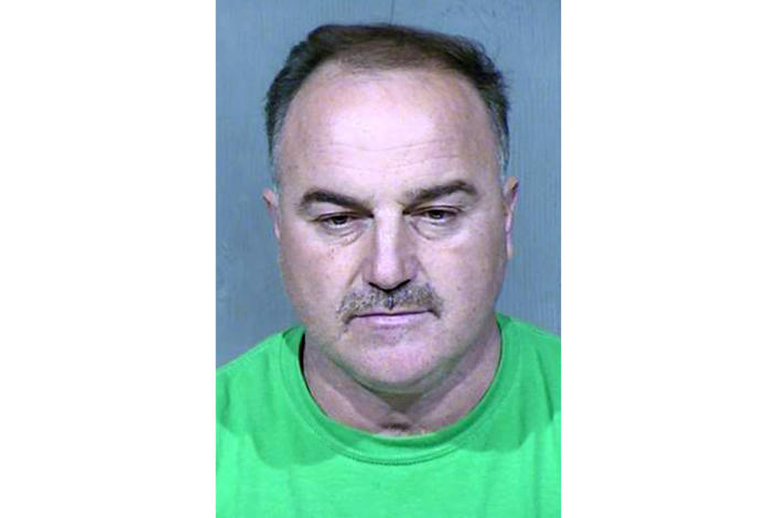 FILE - This undated booking photo provided by the Maricopa County Sheriff's Office shows Ali Yousif Ahmed Al-Nouri, who was arrested in January 2020 in Arizona as part of an extradition request made by the Iraqi government and has been accused of participating in the killings of two police officers nearly 15 years ago in Iraq. Prosecutors on Friday, April 16, 2021, urged a judge to approve the Iraqi government's extradition request for Ahmed, an Iraqi native who came to the United States as a refugee in 2009 and became a U.S. citizen in 2015. Ahmed has denied involvement in the killings. (Maricopa County Sheriff's Office via AP, File)