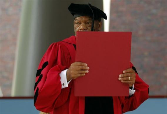 U.S. Congressman John Lewis holds up his honorary Doctor of Laws degree during the 361st Commencement Exercises at Harvard University in Cambridge, Massachusetts, May 24, 2012.