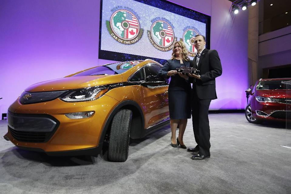 General Motors Executive Chief Engineer Autonomous & Electrified Vehicles and New Technology Pam Fletcher, left, and Bolt Chief Engineer Josh Tavel stand next to a Chevy Bolt after being named top car in the North America at the North American International Auto show, Monday, Jan. 9, 2017, in Detroit. (AP Photo/Carlos Osorio)