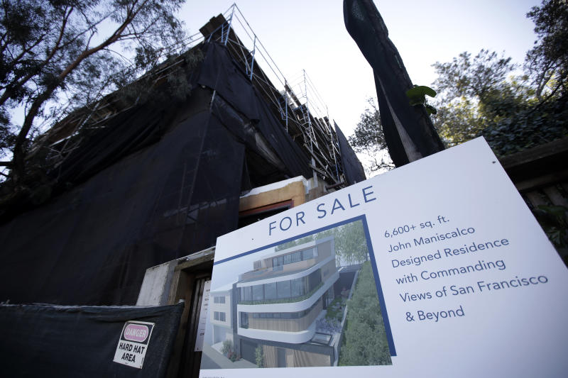 This Feb. 18, 2020, photo shows a real estate sign is shown in front of a home for sale in San Francisco. On Tuesday, Feb. 25, the Standard & Poor's/Case-Shiller 20-city home price index for December is released. (AP Photo/Jeff Chiu)