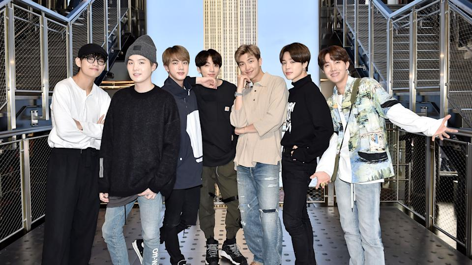 (left to right) V, Suga, Jin, Jungkook, RM, Jimin, and J-Hope from BTS visit The Empire State Building on May 21, 2019. (Photo: Steven Ferdman via Getty Images)