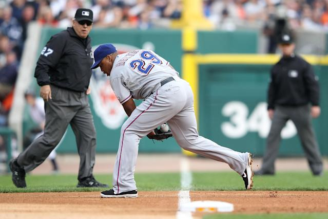 DETROIT, MI - OCTOBER 13: Adrian Beltre #29 of the Texas Rangers fields a ground ball from Victor Martinez #41 of the Detroit Tigers in the second inning of Game Five of the American League Championship Series at Comerica Park on October 13, 2011 in Detroit, Michigan. (Photo by Leon Halip/Getty Images)