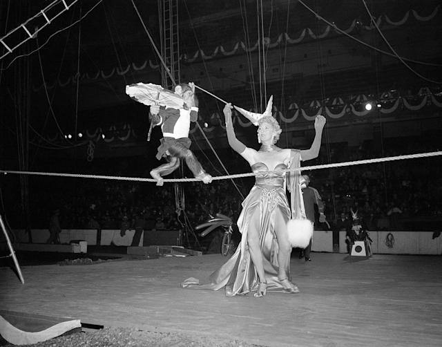 <p>Monkey acts are a favorite with many circus goers so Beatrice Dante puts her chimpanzee through a tight wire number in preparation for the New York opening, April 6, 1949. (AP Photo/Ed Ford) </p>