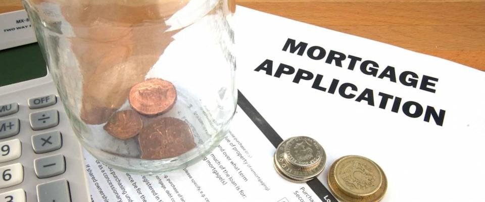 Mortgage application with coins and calculator