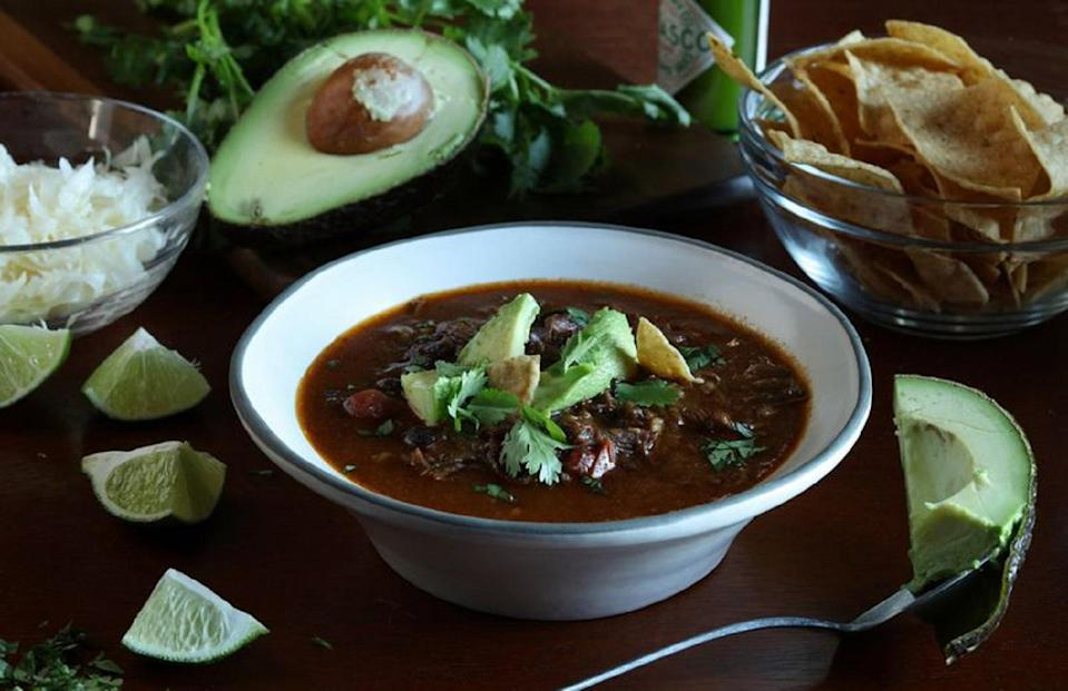 """<p>This recipe includes most of the ingredients you love in a <a href=""""https://www.thedailymeal.com/cook/every-taco-recipe-youll-ever-need-slideshow?referrer=yahoo&category=beauty_food&include_utm=1&utm_medium=referral&utm_source=yahoo&utm_campaign=feed"""" rel=""""nofollow noopener"""" target=""""_blank"""" data-ylk=""""slk:taco"""" class=""""link rapid-noclick-resp"""">taco</a>, but in soup form. For this short rib taco soup, beef short ribs and steak are slow-cooked in a spicy broth. Just ditch the tortillas in favor of a bowl and include all of your favorite taco toppings on this soup.</p> <p><a href=""""https://www.thedailymeal.com/recipes/slow-cooker-beef-taco-recipe?referrer=yahoo&category=beauty_food&include_utm=1&utm_medium=referral&utm_source=yahoo&utm_campaign=feed"""" rel=""""nofollow noopener"""" target=""""_blank"""" data-ylk=""""slk:For the Slow Cooker Short Rib Taco Soup recipe, click here."""" class=""""link rapid-noclick-resp"""">For the Slow Cooker Short Rib Taco Soup recipe, click here.</a></p>"""
