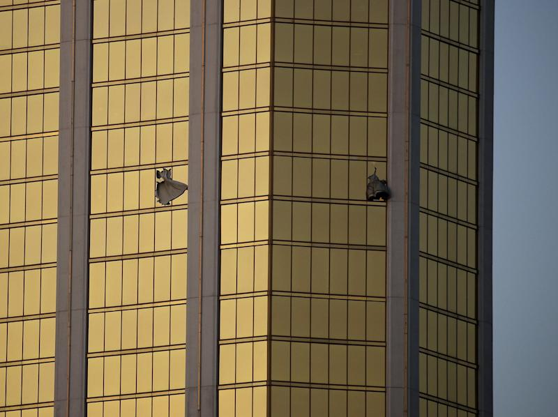 Drapes billow out of broken windows at the Mandalay Bay resort and casino, on the Las Vegas Strip following a deadly shooting at a music festival in Las Vegas on Oct 2, 2017.