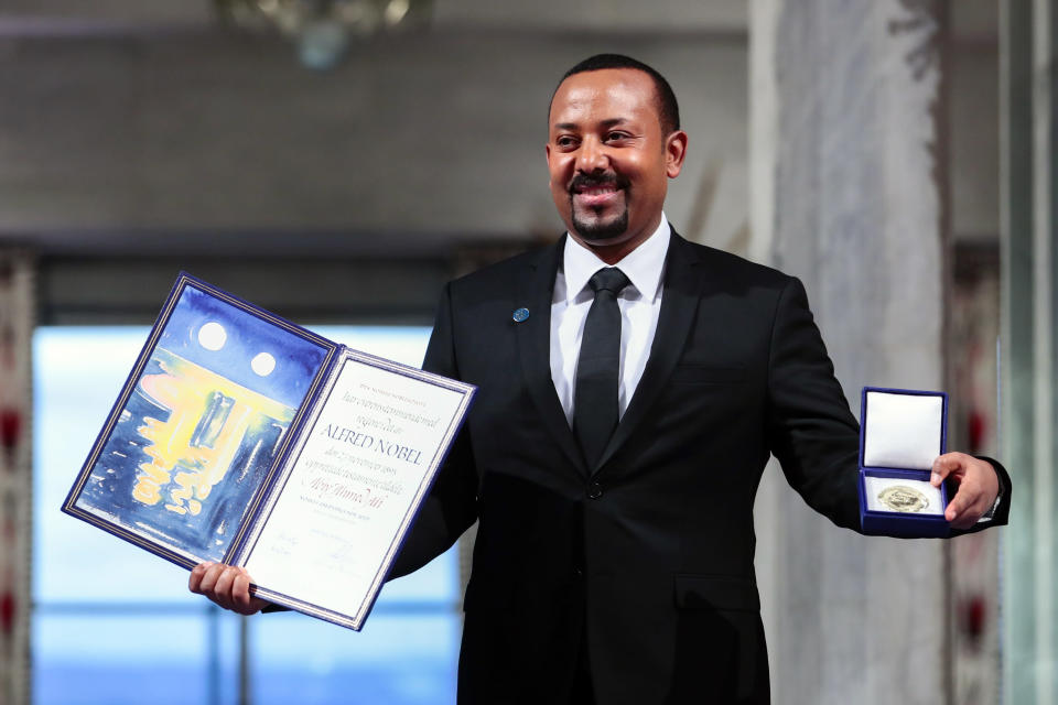 FILE - In this Tuesday, Dec. 10, 2019, file photo, Ethiopia's Prime Minister Abiy Ahmed poses for the media after receiving the Nobel Peace Prize during the award ceremony in Oslo City Hall, Norway. Ahmed left Ethiopians breathless when he became the prime minister in 2018, introducing a wave of political reforms in the long-repressive country and announcing a shocking peace with enemy Eritrea. Now, Abiy is waging war in the defiant Tigray region. (Håkon Mosvold Larsen/NTB Scanpix via AP, File)