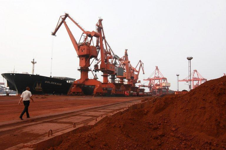 Soil containing various rare earth minerals is being loaded onto a ship at a port in Lianyungang, east China's Jiangsu province, on September 5, 2010. China has announced its closely watched export quota for rare earth minerals in the second half of this year, bringing the full-year total to 31,001 tonnes