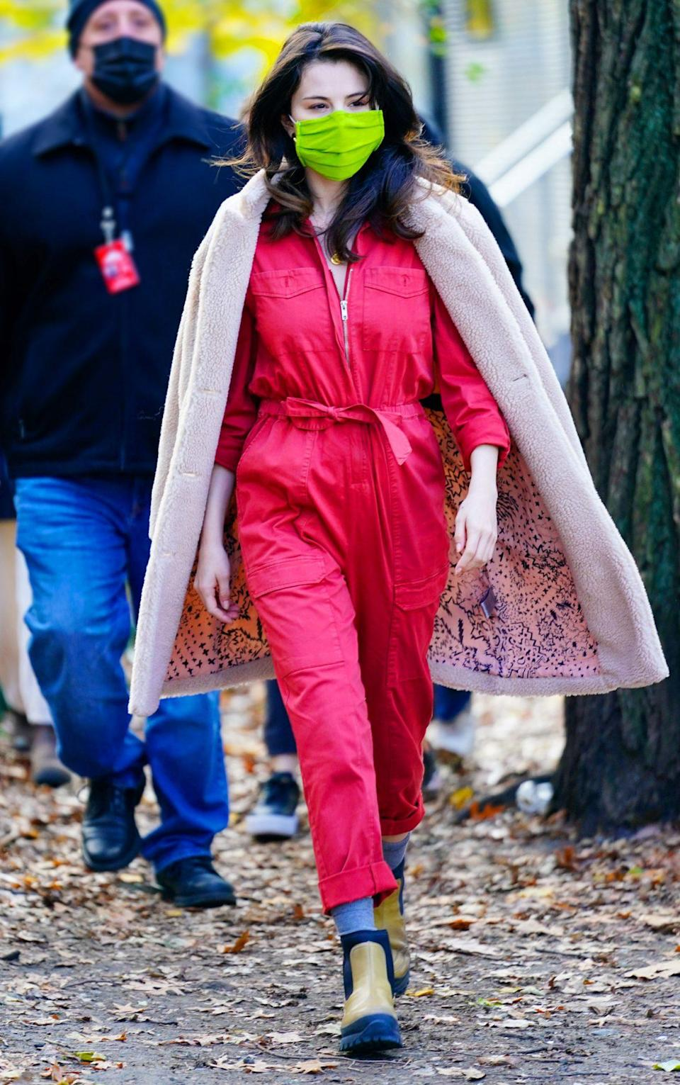 <p>Selena Gomez dons a hot pink jumpsuit and neon mask while on set in N.Y.C. on Monday. </p>