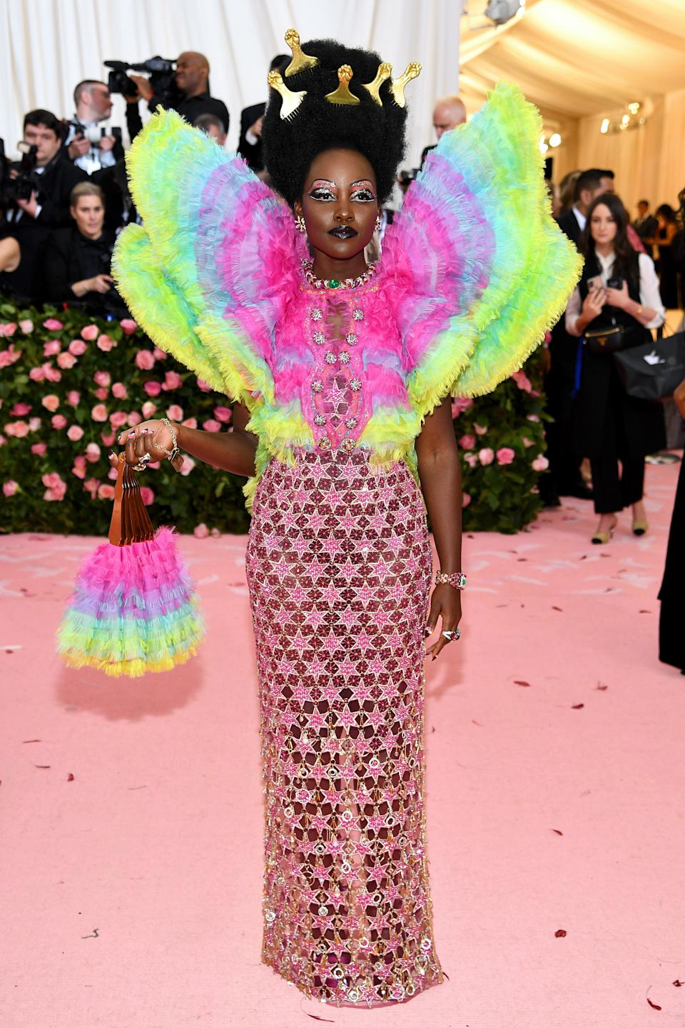 """<h1 class=""""title"""">Lupita Nyong'o in Versace wearing Bulgari jewelry</h1><cite class=""""credit"""">Photo: Getty Images</cite>"""