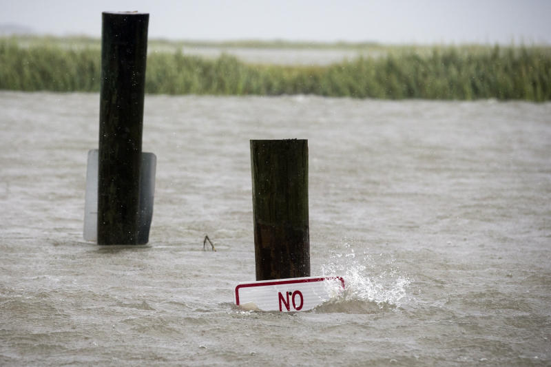 A sign at the Lazaretto Creek boat ramp as is nearly underwater at high tide as Hurricane Dorian makes its way up the east coast, Sept. 4, 2019, toward Tybee Island, Ga. (Photo: Stephen B. Morton/AP)