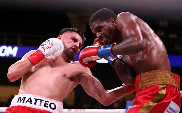 """<a class=""""link rapid-noclick-resp"""" href=""""/ncaaf/players/300168/"""" data-ylk=""""slk:Jose Ramirez"""">Jose Ramirez</a> (L) and Maurice Hooker during their WBO &amp; WBC Junior Welterweight World Championship fight at College Park Center on Saturday in Arlington, Texas. (Getty Images)"""