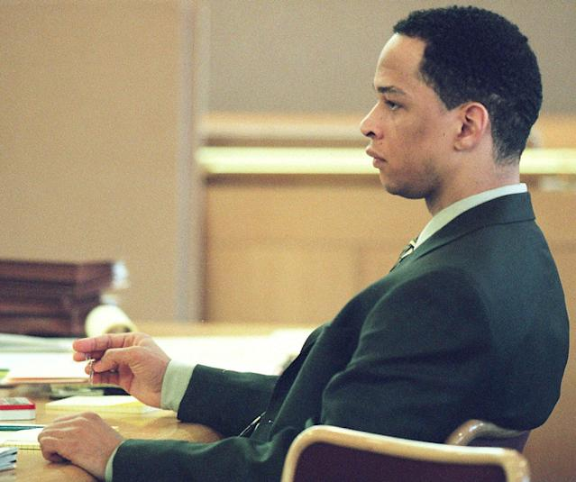Rae Carruth sits at the defense table during his 2001 murder trial. (AP)