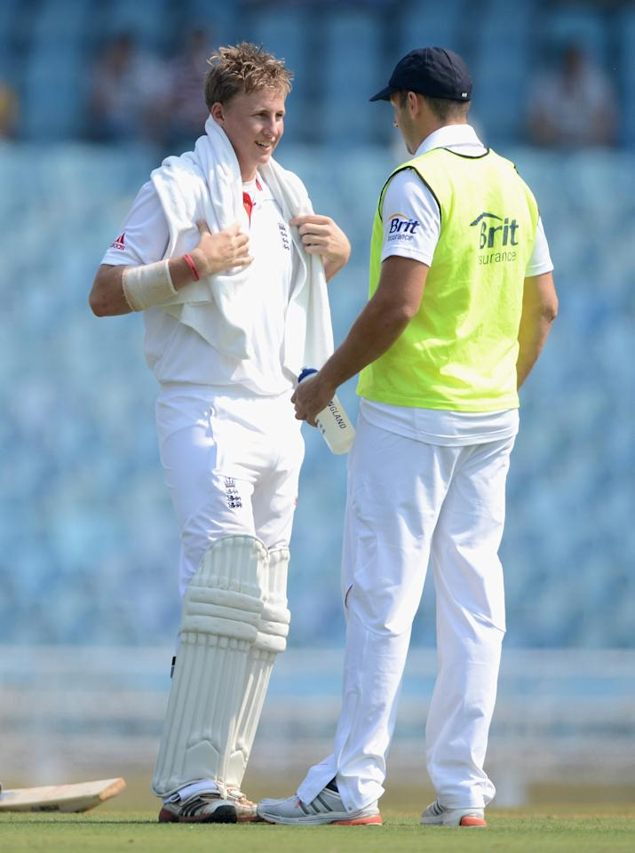MUMBAI, INDIA - NOVEMBER 03:  Joe Root of England cools down alongside 12th man Tim Bresnan during day one of the tour match between Mumbai A and England at The Dr D.Y. Palit Sports Stadium on November 3, 2012 in Mumbai, India.  (Photo by Gareth Copley/Getty Images)