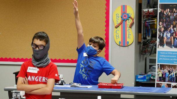 PHOTO: Amid concerns of the spread of COVID-19, students wear masks in the classroom during a summer STEM camp at Wylie High School, July 14, 2020, in Wylie, Texas. (Lm Otero/AP)