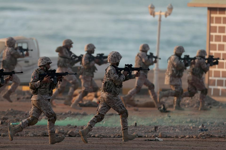 """FILE PHOTO: Members of the United Arab Emirates Armed Forces perform military drills during the """"Union Fortress 6"""" military parade in Al Hamra, Ras al Khaimah, United Arab Emirates November 1, 2019. REUTERS/Christopher Pike"""
