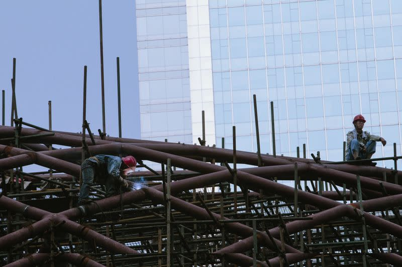 Labourers work on a construction site in Guangzhou, Guangdong province