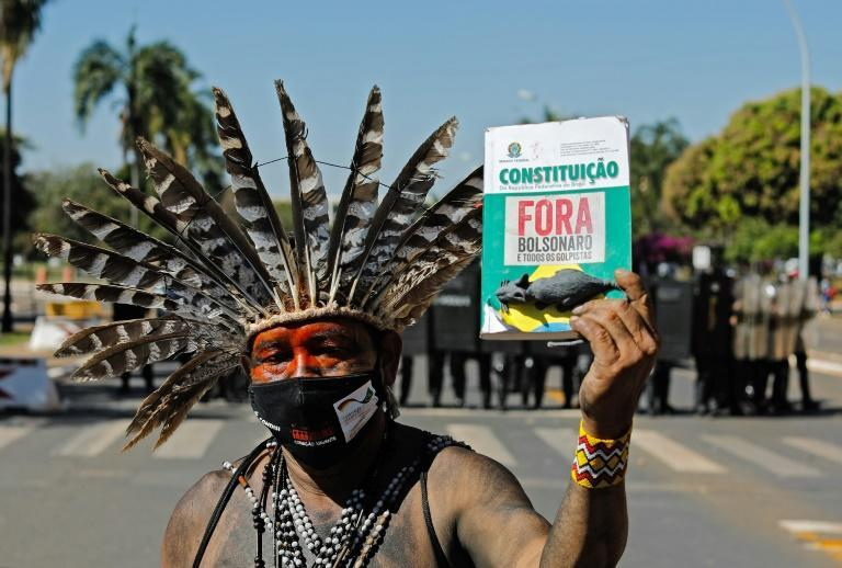 An indigenous man protests outside Brazil's Congress in Brasilia, on June 22, 2021