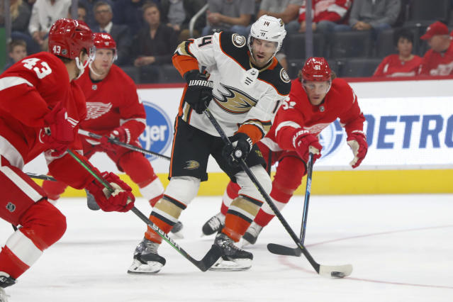 Anaheim Ducks center Adam Henrique (14) skates with the puck against the Detroit Red Wings in the first period of an NHL hockey game, Tuesday, Oct. 8, 2019, in Detroit. (AP Photo/Paul Sancya)