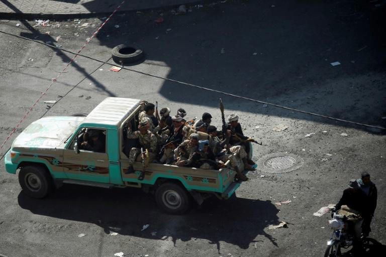 Huthi fighters patrol a street in the Yemeni capital Sanaa on December 3, 2017