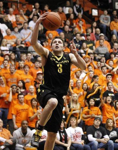 Oregon guard Garrett Sim (3) lays the ball up in the second half during an NCAA college basketball game with Oregon State, Sunday, Feb. 26, 2012, in Corvallis, Ore. Oregon defeated Oregon State 74-73. (AP Photo/Rick Bowmer)
