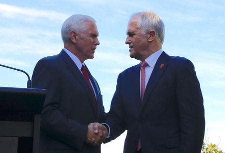 U.S. Vice President Mike Pence (L) shakes hands with Australia's Prime Minister Malcolm Turnbull during a media conference at Admiralty House in Sydney, Australia, April 22, 2017. REUTERS/Jason Reed