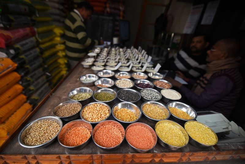 Pulses are kept on display for sale inside a shop at a wholesale market in Guwahati