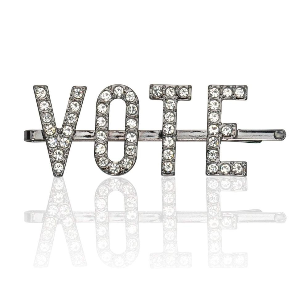 """Get the<a href=""""https://mykitsch.com/products/vote-rhinestone-bobby-pin"""" target=""""_blank"""" rel=""""noopener noreferrer"""">Kitsch vote rhinestone bobby pin</a>for $29."""