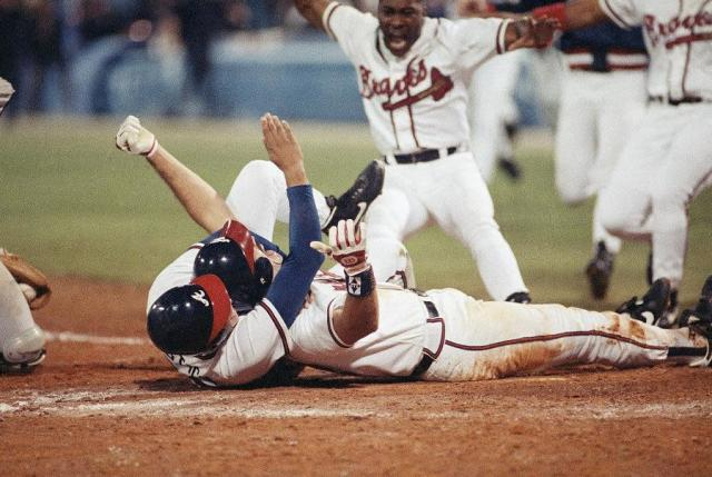 Sid Breams scores the winning run for the Braves in Game 7 of the 1992 NLCS. (AP)