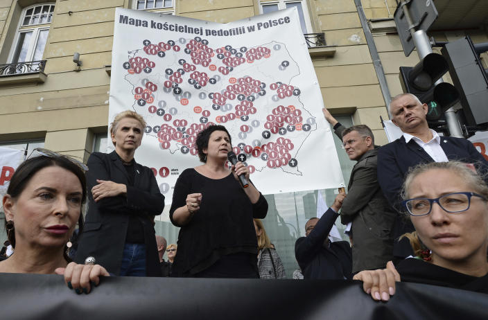 A map is presented showing Poland with 255 documented cases of sexual abuse of minors by the country's Catholic priests, during a demonstration in Warsaw, Poland, Sunday, Oct. 7, 2018. A private foundation in Poland published the map in the latest development pressuring Poland's church to admit and take responsibility for such abuse cases. (AP Photo/Alik Keplicz)