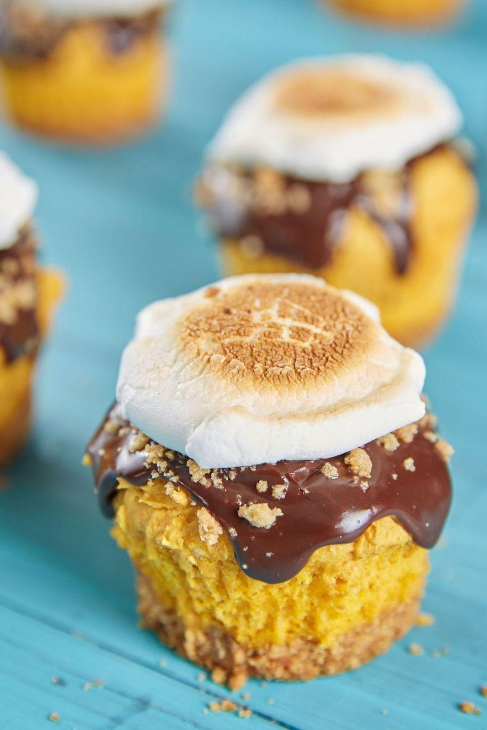 """<p>Anything pumpkin is fit for a Halloween party in our book — and anything s'mores is always welcome.</p><p><em><a href=""""https://www.delish.com/cooking/recipe-ideas/recipes/a49181/smores-pumpkin-cupcakes-recipe/"""" rel=""""nofollow noopener"""" target=""""_blank"""" data-ylk=""""slk:Get the recipe from Delish »"""" class=""""link rapid-noclick-resp"""">Get the recipe from Delish »</a></em></p>"""