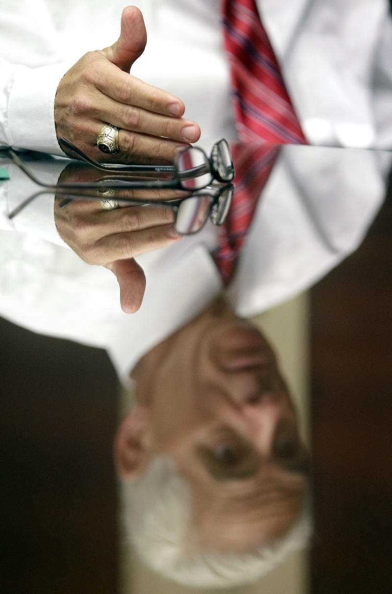 Florida Gov. Charlie Crist is reflected in a glass table top during an interview with the Associated Press Monday, Nov. 29, 2010, at the University of South Florida in St. Petersburg, Fla. (AP Photo/Chris O'Meara)