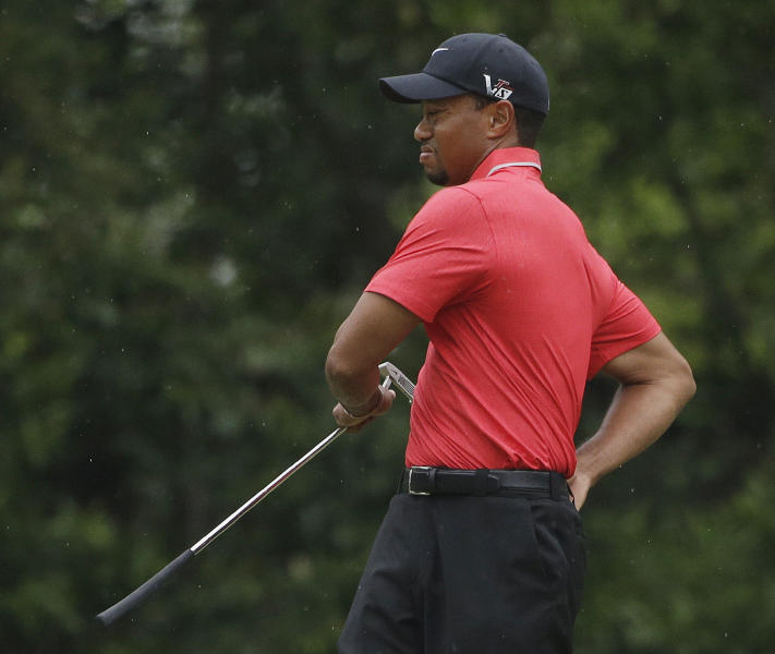 Tiger Woods stretches before putting on the fourth green during the fourth round of the Masters golf tournament Sunday, April 14, 2013, in Augusta, Ga. (AP Photo/Darron Cummings)