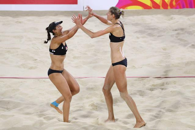 Beach Volleyball - Gold Coast 2018 Commonwealth Games - Women's Gold Medal Match - Australia v Canada - Coolangatta Beachfront - Gold Coast, Australia - April 12, 2018. Sarah Pavon and Melissa Humana-Paredes of Canada celebrate victory. REUTERS/Athit Perawongmetha