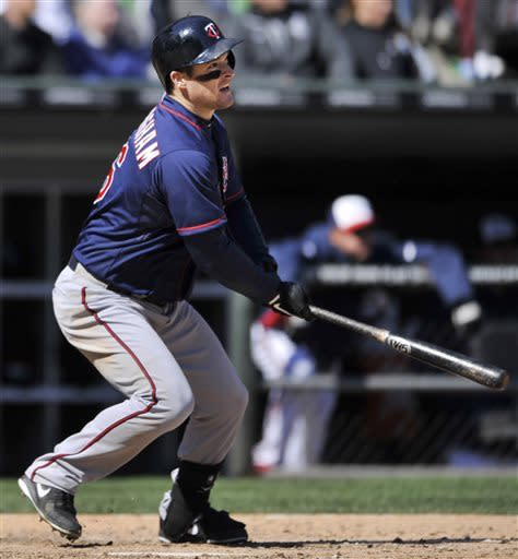 Minnesota Twins' Josh Willingham watches his three-RBI double during the seventh inning of baseball game against the Chicago White Sox in Chicago, April 21, 2013. (AP Photo/Paul Beaty)