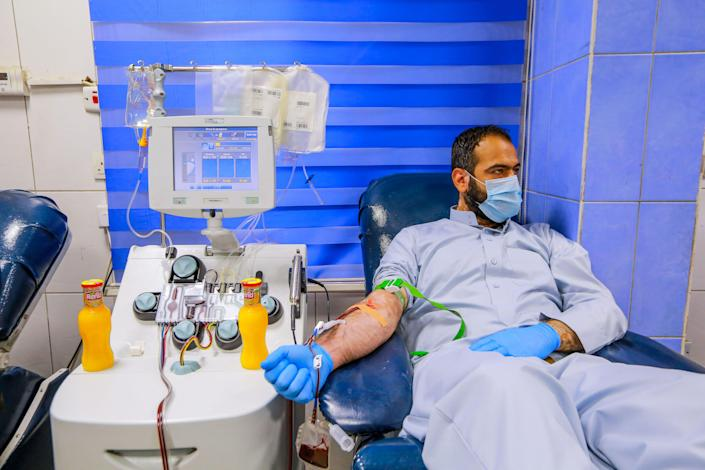 A recovered coronavirus patient donates blood samples at the National Blood Transfusion Center on June 22.