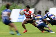 Lito Ramirez (2nd L) outpaces a line of defenders during a match in Silangan, Laguna, south of Manila