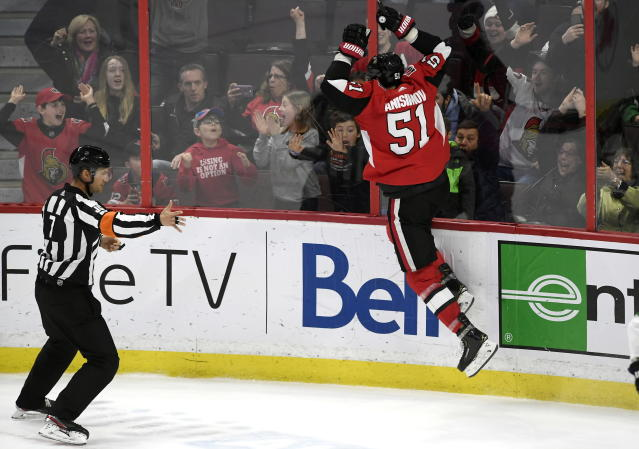 Ottawa Senators center Artem Anisimov (51) jumps against the boards after scoring against the Dallas Stars in overtime during the third period of an NHL hockey game Sunday, Feb. 16, 2020, in Ottawa, Ontario. (Justin Tang/The Canadian Press via AP)