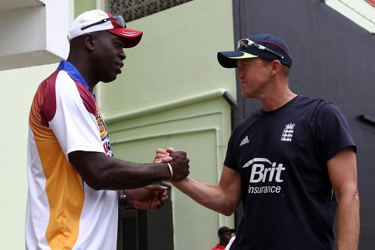 PROVIDENCE, GUYANA - MAY 03:  Otis Gibson of West Indies shakes hands with Andy Flower of England prior to the ICC T20 World Cup Group D match between West Indies and England at the Guyana National Stadium Cricket Ground on May 3, 2010 in Providence, Guyana..  (Photo by Clive Rose/Getty Images)
