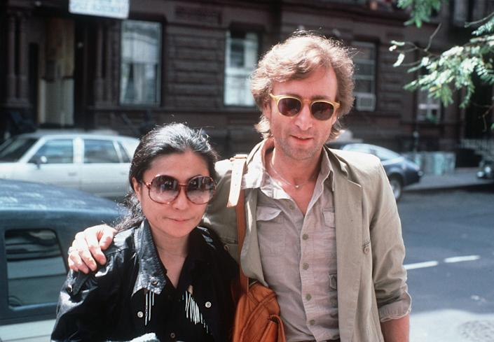 John Lennon and his wife, Yoko Ono, arrive at The Hit Factory, a recording studio in New York City on Aug. 22, 1980. (AP Photo/Steve Sands)