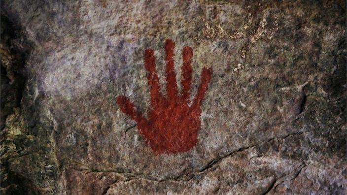 A handprint on Munjiriri cave, part of a Maasai initiation ritual, is seen on Wednesday in Kenya.