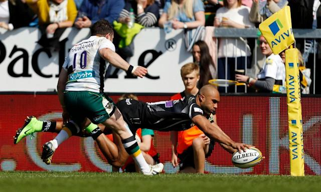 "<span class=""element-image__caption"">Olly Woodburn launches himself over the line to score Exeter's second try against Northampton during the Premiership match at Sandy Park.</span> <span class=""element-image__credit"">Photograph: Paul Harding/PA</span>"