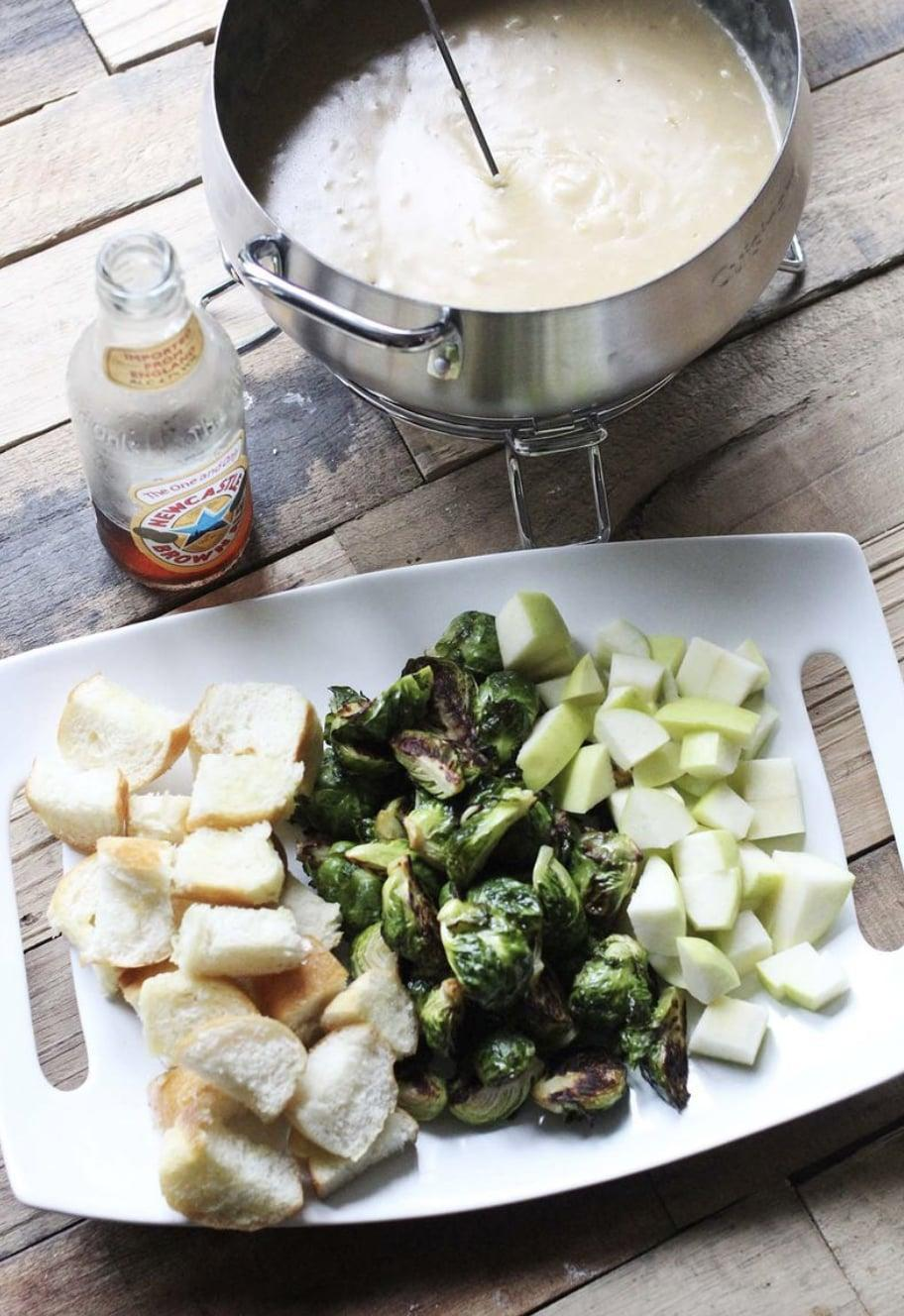 "<p>Ready to take fondue night to the next level? Here you go. This Newcastle recipe is made with garlic, gruyère cheese, and beer, meaning it's not only easy to make, but it's even easier to enjoy. Dig in!</p> <p><strong>Get the recipe</strong>: <a href=""https://abeautifulmess.com/newcastle-fondue/"" class=""link rapid-noclick-resp"" rel=""nofollow noopener"" target=""_blank"" data-ylk=""slk:Newcastle fondue"">Newcastle fondue</a></p>"