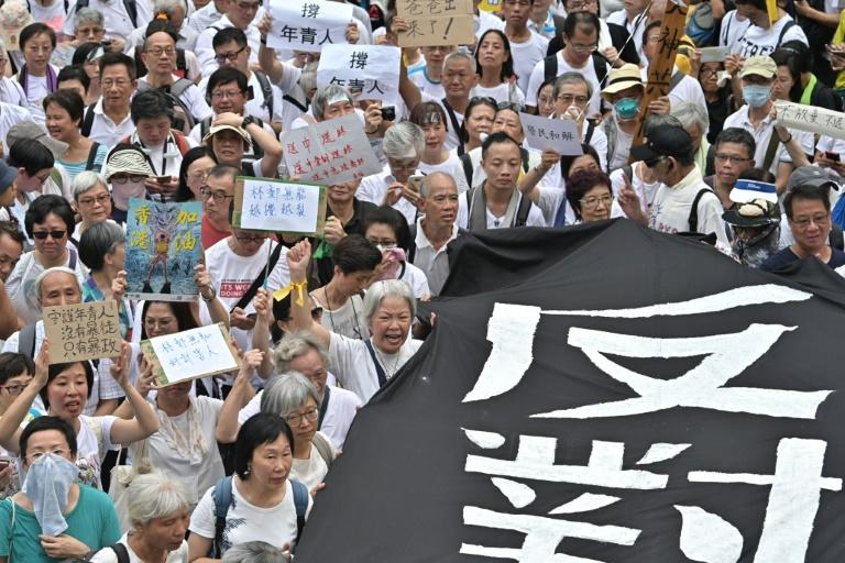 Long lines of older demonstrators snaked through the city's streets in tropical heat, a powerful display in a culture where respect for one's elders remains paramount (AFP Photo/Anthony WALLACE)